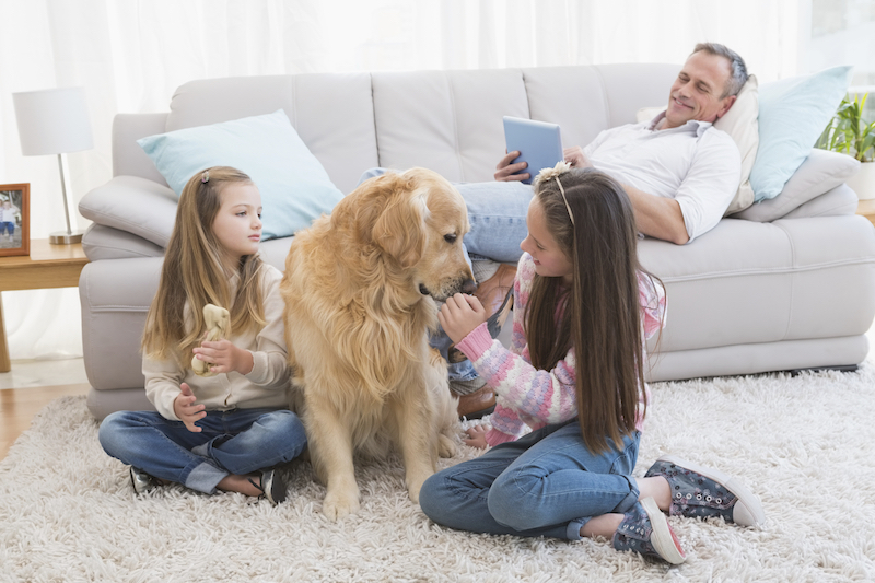 family with dog in home